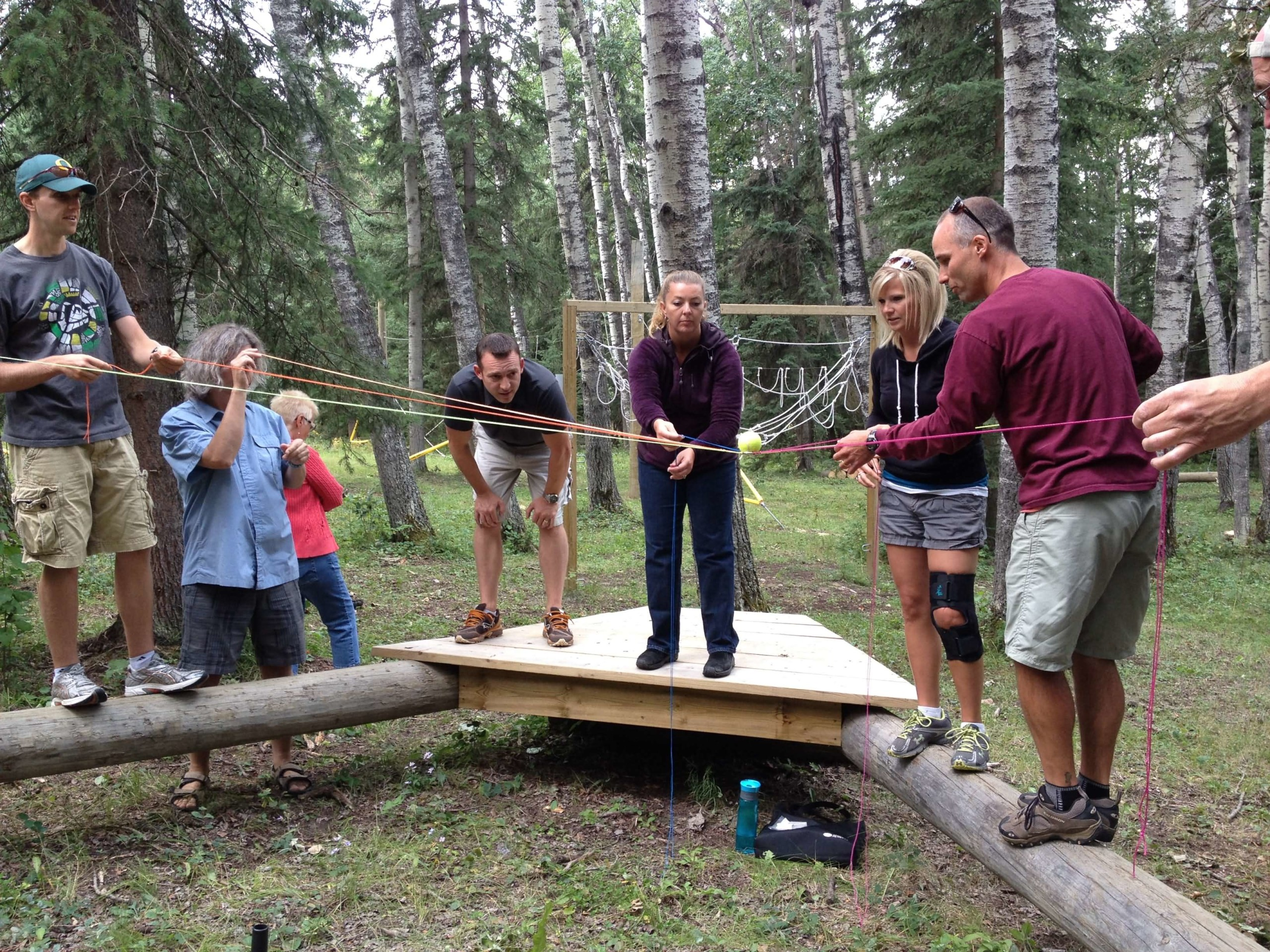 People complete low ropes challenge, focus on end goal